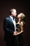 Studio shot of bride and groom. On a dark background Royalty Free Stock Images
