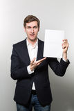 Studio shot of businessman with sheet of paper Stock Images