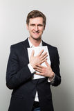 Studio shot of businessman with sheet of paper Royalty Free Stock Images