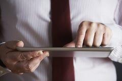 Studio Shot Of Businessman Using Digital Tablet Royalty Free Stock Photography