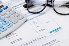 Studio shot of calculator and glasses over some receipt. Studio shot Stock Photo