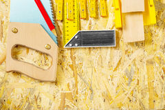 Carpentry tool set on plywood board Stock Photography