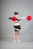 Studio Shot of Cheerleader Posing Royalty Free Stock Photo