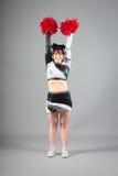 Studio Shot of Cheerleader Posing Royalty Free Stock Image