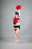 Studio Shot of Cheerleader Posing Stock Images