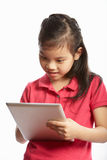 Studio Shot Of Chinese Girl With Digital Tablet Stock Photography