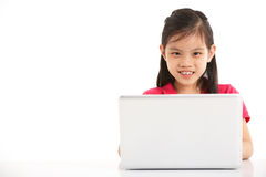 Studio Shot Of Chinese Girl With Laptop Stock Photography
