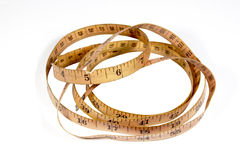 Studio Shot Coiled Vintage Tape Measure on White Stock Photo