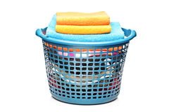 Studio shot of colorful towels in a laundry bin Stock Image