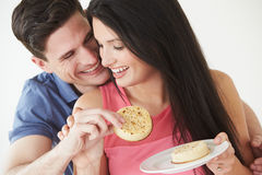 Studio Shot Of Couple Eating Crumpets Royalty Free Stock Photography