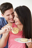 Studio Shot Of Couple Eating Crumpets Stock Image