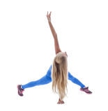 Studio shot of cute blonde doing fitness exercises Stock Image