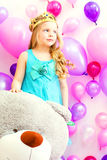 Studio shot of cute girl posing with teddy bear Royalty Free Stock Images