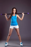Studio shot of cute sporty girl posing with fitbar Royalty Free Stock Photo
