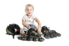 Studio shot of cute toddler with rollerskates Royalty Free Stock Photo