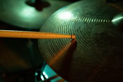 Studio shot of cymbals and drum stick stock image