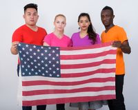 Studio shot of diverse group of multi ethnic friends holding the stock images