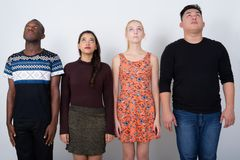 Studio shot of diverse group of multi ethnic friends looking up stock photography