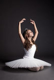 Studio shot of dreamy graceful ballerina. On gray backdrop Royalty Free Stock Image
