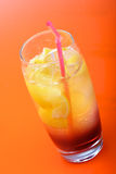 Studio shot of drink on orange background Stock Photo