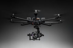Studio shot of drone with digital camera. Multicopter closeup on studio background. Drone with professional camera. Octocopter for filming stock photo