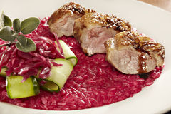 Duck saute with red beet risotto Stock Image