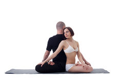 Studio shot of Europeans engaged in yoga. Image of Europeans engaged in yoga, isolated on white Stock Photography