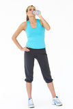 Studio Shot Of Exercising Woman Drinking Water Royalty Free Stock Photography