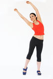 Studio Shot Of Exercising Woman Stock Images