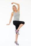 Studio Shot Of Exercising Woman Stock Image