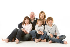 Studio Shot Of Family Group Sitting. In Studio royalty free stock photography