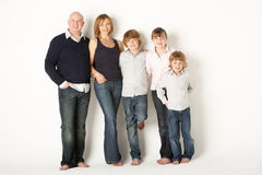 Studio Shot Of Family Group Standing In Studio. Smliing at camera royalty free stock photos
