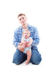 Studio shot of father sitting with his son Stock Photo