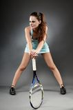A studio shot of a female tennis player with racket Royalty Free Stock Photo