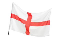 A studio shot of a flag of England waving. Isolated on white background Royalty Free Stock Photography