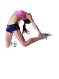 Studio shot of flexible athletic girl jumping Royalty Free Stock Photo