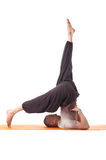 Studio shot of flexible athletic man doing yoga Stock Photo