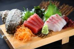 Fresh sashimi combo. Studio shot of fresh sashimi combo on black background royalty free stock photography