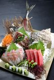 Studio shot of fresh sashimi combo plate. On a dining table royalty free stock image