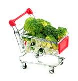 Studio shot of freshly cut green broccoli in mini shopping troll Royalty Free Stock Photos