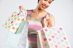 Studio Shot Of Funky Woman With Shoppping Bags Royalty Free Stock Image