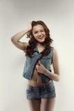 Studio shot of funny teen model winks at camera. Studio photo of funny teen model winks at camera Stock Photo