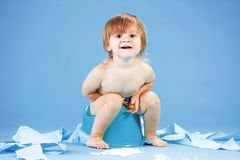 Cute toddler on potty chait Stock Images