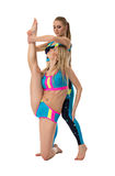 Studio shot of girl helps her friend stretching Royalty Free Stock Photography