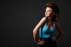 Studio shot of girl with makeup and hairstyle. Studio shot of attractive girl with blue makeup and abstract hairstyle Stock Photography