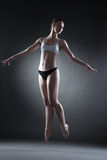 Studio shot of graceful dancer posing in jump Stock Photos