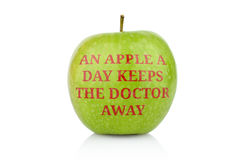 Studio shot of green apple with inscription doctor away Stock Photos