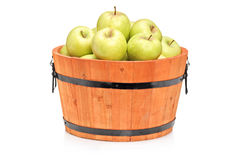 Studio shot of green apples in a wooden barrel Stock Photos