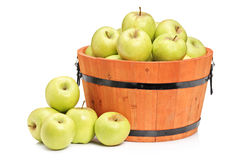 A studio shot of green apples in a wooden basket Stock Images