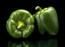 Studio shot of green bell peppers isolated on black Royalty Free Stock Photography